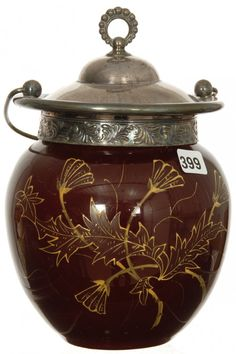 "8"" CASED DARK CRANBERRY ART GLASS BISCUIT JAR WITH WHITE INTERIOR, ENAMEL THISTLE DECOR, SILVERPLATE LIDCAND BAIL"