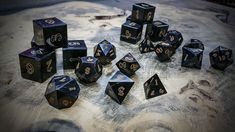 "Water Buffalo Horn Polyhedral Dice --- ""The golden numbers are not painted. They have been laser engraved as are all of our dice. Buffalo horn does not turn black in response to heat. Instead, it turns the golden hue seen here."""