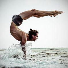 Man doing yoga in water......