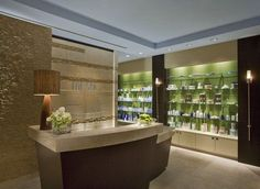 Stone wall + reception desk | Chiropractic Office Design | Pinterest