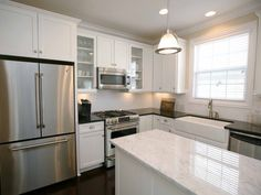 Stainless GE Cafe appliances, black granite counter tops, & carrara marble slab island!