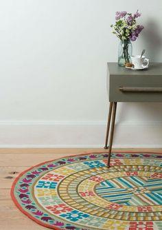 Ideas para decorar con una alfombra redonda.