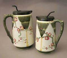 Wedgwood Majolica Syrup Pitchers. Argenta coloration.