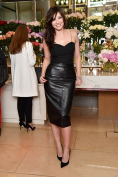 Daisy Lowe looked great this summer, teaming a midi length black leather pencil skirt with a simple cami vest and classic black court shoes. - Badmademoiselle