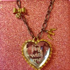 """Betsey Johnson Fly With Me heart necklace Betsey Johnson Fly With Me Necklace. Front has """"fly with me"""" etched on a mirrored heart, and back is gold. Black chain features cute bow, bird and rhinestone clustered charm. Never been worn excellent condition! Circa 2009, rare and hard to find. Pre bankruptcy piece. Betsey Johnson Jewelry Necklaces"""