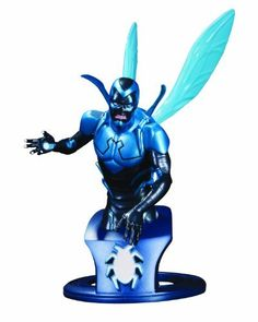 """DC Collectibles DC Comics Super-Heroes: Blue Beetle Bust by DC Collectibles. $49.94. Sculpted by Steve Kiwus. Recreates the all-new look of fan-favorite Jaime Reyes from DC Comics-The New 52. Packaged in a 4-color box. Measures approximately 6.6"""" H x 5.7"""" W x 3.75"""" D. Hand-painted, cold-cast porcelain. From the Manufacturer                Bonded with a mystical scarab of unknown origins, Jaime Reyes is back in the DC Comics–The New 52. This skillfully designed bust ..."""