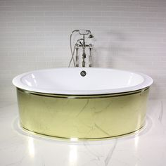 'The Ashton' 65″ Oval Cast Iron Tub with POLISHED BRASS skirt