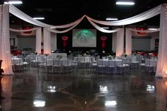 An elaborate decorated wedding reception - Marconi Automotive Museum & Foundation for Kids (Tustin, CA).