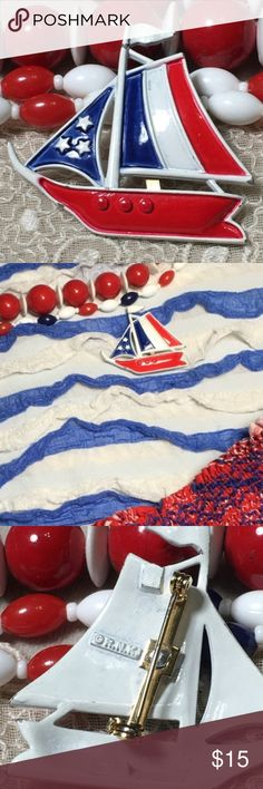 """Vintage 70's Enamel RNK Patriotic Sailboat Brooch Row, row, row your boat gently down the stream.  Vintage enamel red, white and blue sailboat brooch.    Some enamel loss and bending near the flag.   Measures 2"""" x 2"""". Marked RNK. Vintage Jewelry Brooches"""