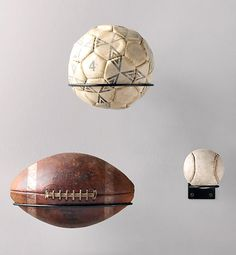 easy ways to upgrade a man cave..Play Ball You can always remember those victorious moments on the field by highlighting your lucky ball with a simple iron rack.