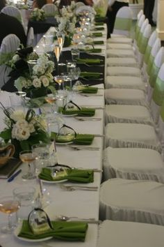 dont like chair covers at all! but obviously like the green and the low centerpieces...no need to obstruct the view