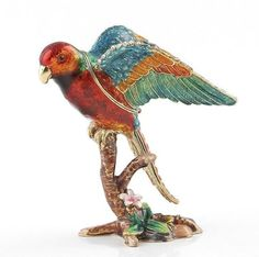 """Colorful Parrot Trinket Box Item No. KB00216A01 $51.09 This Faberge style trinket box is constructed from a pewter base. The box is hand enameled, and decorated with Austrian crystals. This box is hinged, and features a magnet for a clasp. The magnet enables the box to open easily, but close firmly. The box is great just for display, for holding or giving as a gift a small piece of jewelry, or for some of your memorable items. Colorful Parrots, Austrian Crystal, Keepsake Boxes, Trinket Boxes, How To Memorize Things, Great Gifts, Crystals, Pewter, Beautiful"