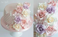 Pink cascading sugar flowers birthday cake