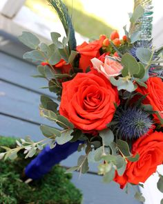For the #bridesmaids red orange #roses #bluethistle peach #sprayroses #hypericum berries #eucalyptus and a touch of #peacockfeathers to bring out the #royalblue of the #bridesmaidsdresses. @blairejb #thefloralcottageflorist #royalbluewedding #bridesmaidsbouquet #bridesmaidbouquet #weddingbouquet #weddingflowers #fallwedding #fallweddings #autumnwedding #fallcolors #nolawedding #nolaweddings