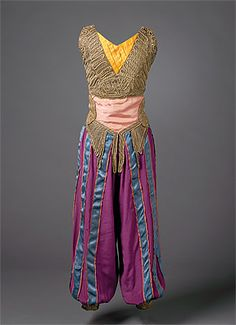 Léon BAKST   designer Belarus (Russia) 1866 – France 1924   France from 1912  producer 1909 – 1929  Marie MUELLE   costumier France      Costume for a dancing girl (almée) or odalisque c.1915–30s   cotton, metallic braid, rayon, lamé, metal fasteners   centre back 46.0 (h) cm   Purchased 1973   National Gallery of Australia, Canberra  NGA 1973.270.48