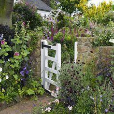 Plant mixed flowers in lieu of grass.countryliving #Gardenpaths