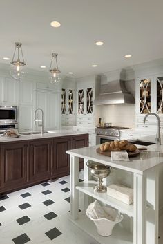Embassy Row kitchen by #WoodMode, shown in Putty and Classic Walnut finishes on Alexandria door style.