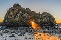 Sunlight shining through the Keyhole Rock in Big Sur, California