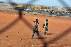 SUDAN. Sudanese soldiers walk in the oil town of Heglig on April 24. South Sudan's leader accused Sudan of declaring war as Khartoum's warplanes bombed border regions in defiance of international calls for restraint. (Ebrahim Hamid/AFP/Getty Images) #