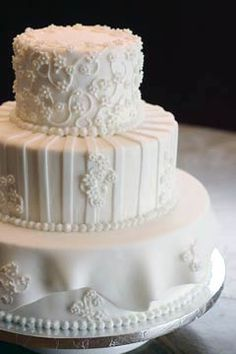 Three tiered white winter wedding cake. Each layer is different and beautifully decorated with rolled fondant. From lorijohernandez's www.flickr.com              ........   #wedding #cake #birthday