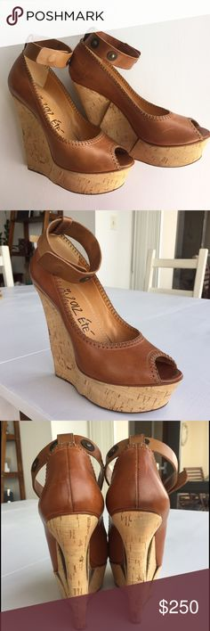 Lanvin 2012 Eté Sky High Brown Leather Wedge Lanvin 2012 Eté High End Designer platform sandals with crossover slingback ankle strap. Cork wedge with tiered detail and 6 inch heel. Size Marked 40 (Fits like 8 1/2). Currently being sold on ebay for $300. Excellent Condition!! Lanvin Shoes Wedges