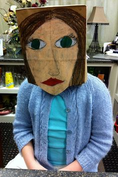 Portrait mask on brown paper bag with oil pastels...art-making activity during a student reception