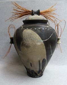 Large Raku Cover Jar with Reeds by julianopottery