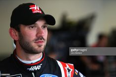 Daniel Suarez, driver of the Haas Automation Ford, stands in the garage area during practice for the Monster Energy NASCAR Cup Series Advance Auto Parts Clash at Daytona International Speedway on. Get premium, high resolution news photos at Getty Images Daniel Suarez Nascar, Monster Energy Nascar, Daytona International Speedway, Car And Driver, Race Cars, Ford, Baseball Cards, News, Drag Race Cars
