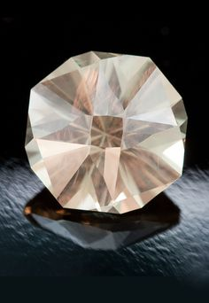 LaBelle • A Radial Design in Oregon Sunstone by Jeffrey Hunt 6.40 carats • 12.3 x 12.3 x 8.8 mm Light Schiller throughout.