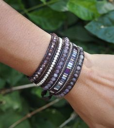 Crafted with a combination of semi-precious stones, crystals and plated metal on grey cord, this wrap bracelet is designed to give you an effortless layered look.  ✧ Mix include: Amethyst, Agate, crystal, japan seed beaded, plated metal, plated chain. ✧ Length : 82cm with adjustable. ✧ Closure : Button ✧ Fits a 6 to 7 inch wrist wrapped 5 times.   PLEASE NOTE : The handcrafted nature of this product will produce minor differences in design, sizing and weight. Variations will occur from piece…