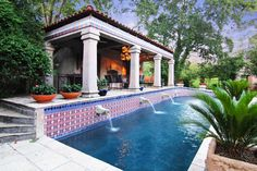 Romanesque columns, a grand Italian style poolside cabana with fireplace, wet bar and summer kitchen.