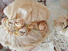 ivory hat with pastel ribbon roses