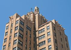 Kean Apartments, Detroit    The top portion of the Kean Apartments which feature many eagle head gargoyles. If you look at the leftmost wing of the building in this view, the two central piers emphasize the vertical while the corner windows are a typical feature of many Art Deco apartment buildings in Detroit.