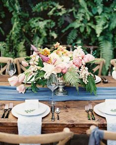 Pink Wedding Centerpieces We Love | Martha Stewart Weddings - The fronds in this exotic pink arrangement tie the centerpiece back to its fern-filled surroundings.