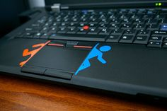 Portal inspired vinyl decals for the Macbook by DisaDesigns. $3.50, via Etsy.