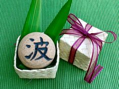 """Japanese Kanji Rock, with Hawaiian Lauhala gift box, Ceramic Incense burner, Wave, Star, Light, Dove, Holiday Good-luck gift, 2""""D x 1 1/2""""H by AumakuaPottery on Etsy"""