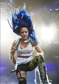 Alissa White-Gluz's epic head-bangs and hair-flips onstage wouldn't be the same without her signature #ManicPanic blue mane!