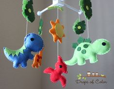 """Like this but with Monsters!   Dinosaur themed nursery mobile - """"Dino Land / Dinosaurs"""" Design. $80.00, via Etsy."""