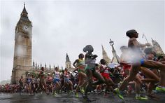 Womens marathon running in rain past Big Ben