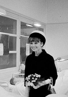 Audrey Hepburn photographed by Jack Garofalo in a hospital in Paris, January 12, 1962