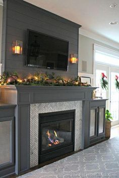 A gorgeous fireplace transformation! #foyerremodel