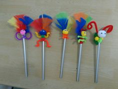 Pencil toppers, made from pipe cleaners, pompoms, feathers, googlie eyes and hot glue.