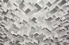 """John Powers creates geometric installations and sculptures that use simple blocks to form interesting patterns with depth and form. The zoomed in view of these pieces makes them look like more like computer generated images than tangible art. Powers states, """"I very much like that my work looks digital, that it reflect my exposure to the technologies around me, but I like also that it is handmade out of base materials."""""""