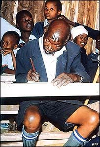 """Kenya's Kimani Nganga Maruge - the oldest man in Kenya to start school - aged 84, and the oldest primary school student in the world. Denied an education as a child, he finally got an opportunity to study when free education was introduced in Kenya in 2003, attending the same school as some of his 30 grandchildren and becoming """"head boy"""". Mr Maruge died in 2009, aged 89."""