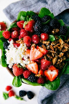 The BEST sweet lemon poppyseed dressing (no mayo), easy candied pecans, and fresh berries over a bed of spinach.