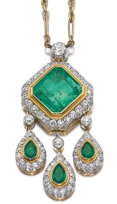 EMERALD AND DIAMOND PENDENT NECKLACE Collet-set with a step-cut emerald, suspending three detachable pear-shaped emerald pendants, framed with circular-cut diamonds, from a detachable chain, length approximately 420mm, may be worn with an additional brooch fitting or earring fittings, fitted case.