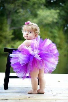 Beautiful baby girl in her purple and white tutu.  Too, too cute!