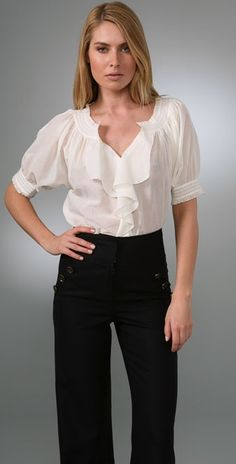 """Diane von Furstenberg Figue Top $185.00 This cotton top features a subtle jacquard pattern and pointelle accents throughout. Picot-edged ruffles and ruching at collar and cuffs. 3-button closure and picot-edged cascading ruffles at split V neck. Pintucking at front and back. 3/4 dolman sleeves. Semi-sheer. * 23"""" long, measured from center back. * Fabrication: Voile."""