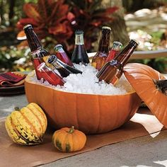 Pumpkin Cooler = Hollow out pumpkins and insert a glass bowl filled with ice and seasonal brews for a spirited display! Z