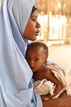 SAHEL FOOD CRISIS - Niger, 2012: Farida Ousmane, 16, holds her 9-month-old brother, Laouli Ousmane, at the UNCEF-supported Routgouna Health Centre, in the town of Mirriah, Mirriah Department, Zinder Region. They are waiting for Laouli, who is malnourished, to be examined.  With prompt global support, a full-scale nutrition crisis can still be averted. - © UNICEF/NYHQ2012-0176/Olivier Asselin  - http://www.unicef.org/